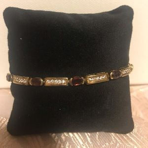 8 in. 14K gold bracelet with garnets and diamonds